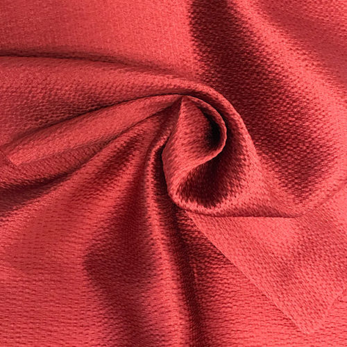Textured red polyester fabric